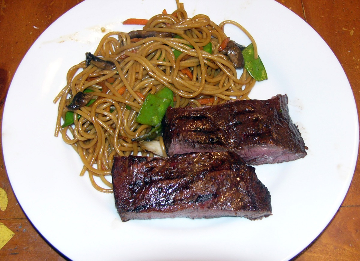 asian marinade flank steak with stir fried spaghetti