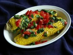 Grilled corn with tomato herb spread