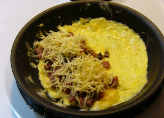 Once egg has set, add fillings to half the omelette.