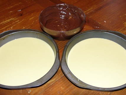 Step 1 - Make favorite yellow cake batter. Reserve 1 cup, divide remaining batter between prepared baking pans. To reserve batter, add 1/2 cup good quality baking cocoa.