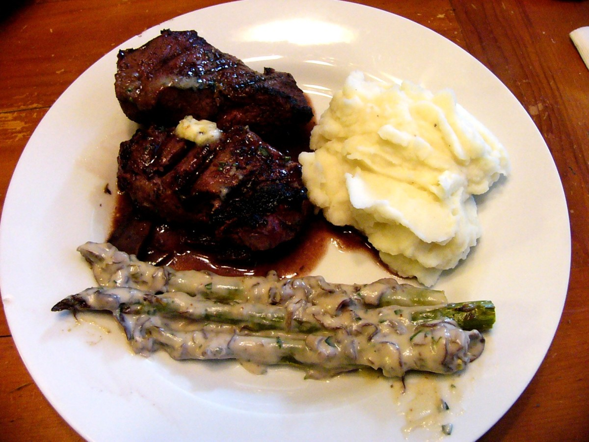 Filet Mignon in Red Wine Reduction Sauce with Tarragon-Garlic Butter ...