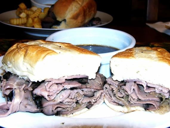 Pile warmed roast beef on Steak Rolls. Slice sandwich in half for easy dipping. Serve along side Au Jus in a small bowl or ramekin.