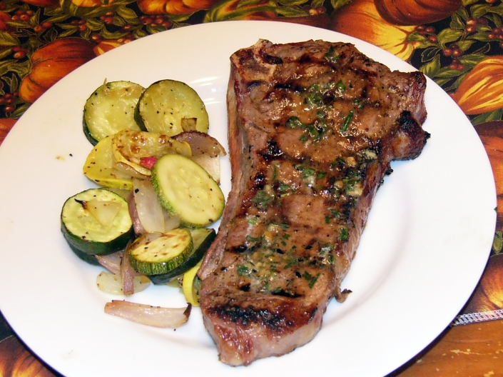 Garlic-Rubbed New York Steaks with Savory Butter