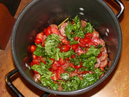 Roughly tear about 15-20 basil leaves and scatter over tomatoes.