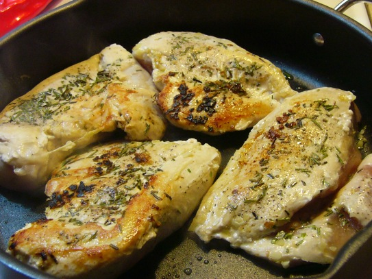 Once chicken is nicely browned on one side, turn and brown the other side until golden.