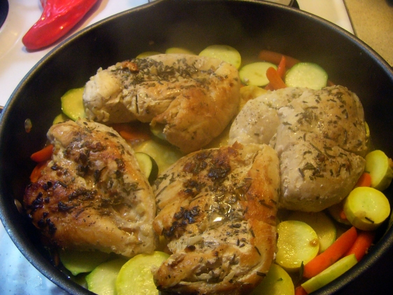 Once chicken is browned and almost cooked through (very little pink), remove chicken from skillet. Spread vegetables into the pan, season with lemon juice, then return chicken breast, topping with more fresh squeezed juice. Cover and cook to desired doneness of vegetables.