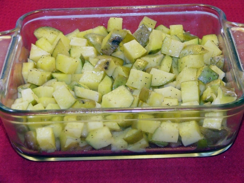 Once potatoes are cubed, drizzle with olive oil, then season well with salt and pepper. Zap potatoes for about 10 minutes in the microwave.