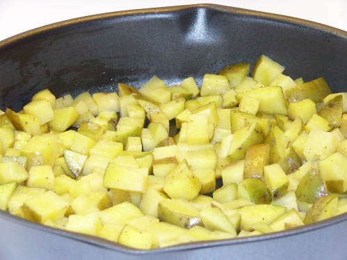 Dump partially cooked potatoes into a skillet large enough to hold all the ingredients. Drizzle with remaining olive oil and fry over medium-high heat.