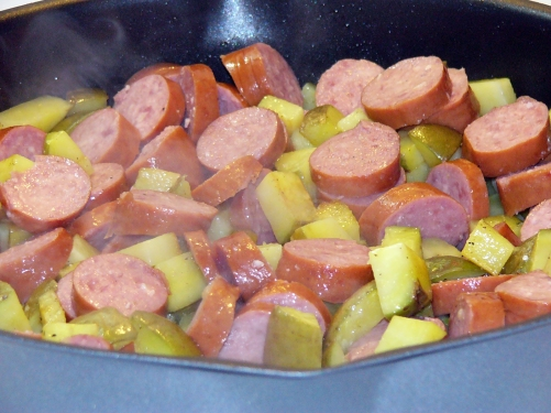 Add coin cut sausage to the skillet with potatoes. Stir and toss to blend.