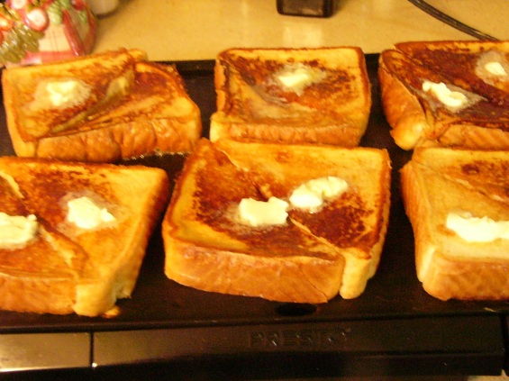 Turn toast, pat with a little butter while still on the hot griddle to allow butter to melt into the toast. Continue to cook until golden, about 3 minutes.