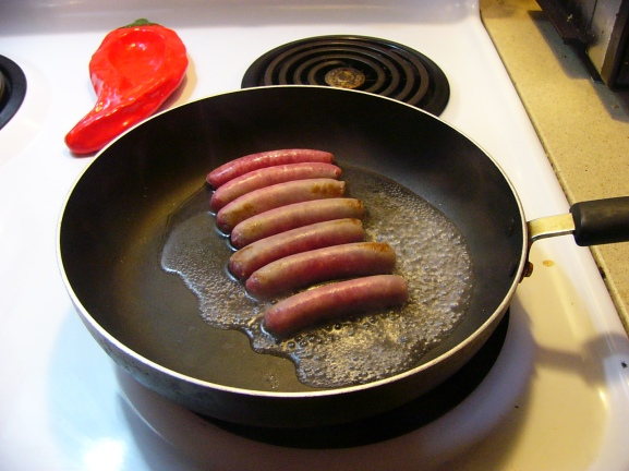 When the skillet is warm, add about a 1/4 cup of water. The water will start to sizzle and the sausage browns.