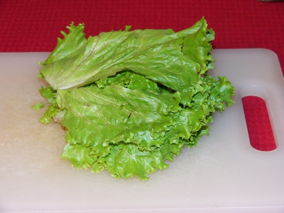 To shred lettuce, stack lettuce leaves into a nice pile.