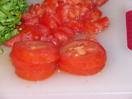 Chop tomatoes and set aside until ready to use.