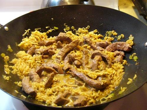 Return beef to wok. Stir quickly.