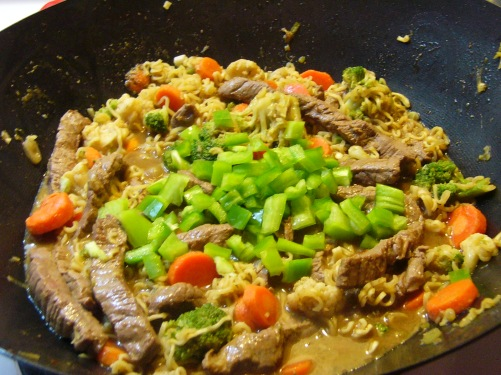 Add green peppers and red pepper flakes. Stir into mixture.