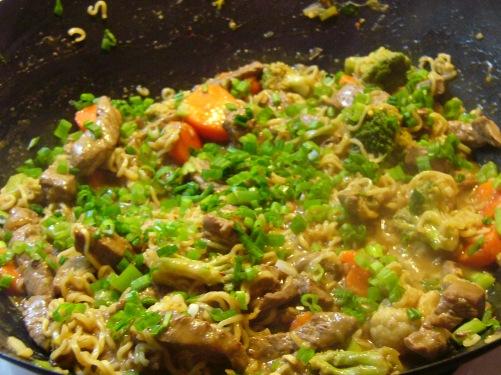 Add green onion tops, mix.