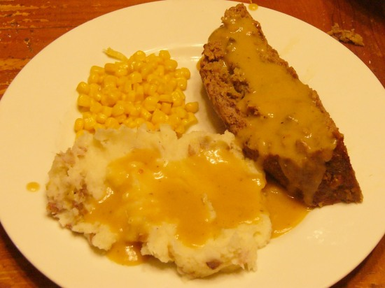This Stuffing-Stuffed Meatloaf is great with buttery mashed potatoes smothered in gravy and sweet corn. Definitely a home-spun comfort supper.