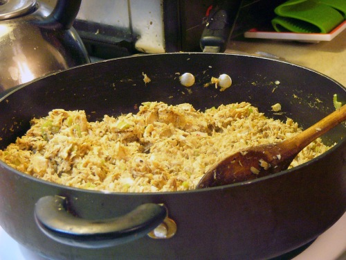 Warm shredded chicken meat, onions, celery and a little enchilada sauce in a high-sided skillet over medium heat.