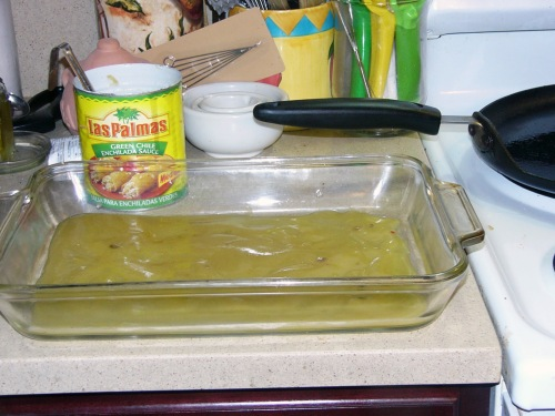 Ladle some enchilada sauce into a casserole dish. Set aside until ready to use.