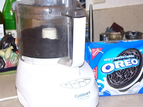 In a food processor, make the cookie crumbs for the crust.