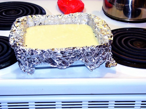 Once the filling is made, pour it into over your cookie crust in a foil lined pan.