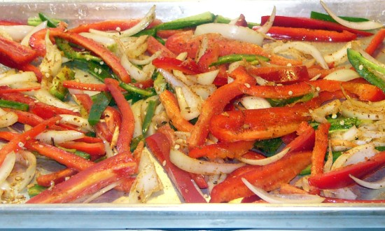 Prepare vegetables, spread over baking pan. Season and toss.