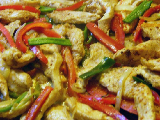 Half way through baking time, remove from oven, drain excess liquid and toss to blend. Return to oven and finish baking. Fajita filling can be served straight from the pan.