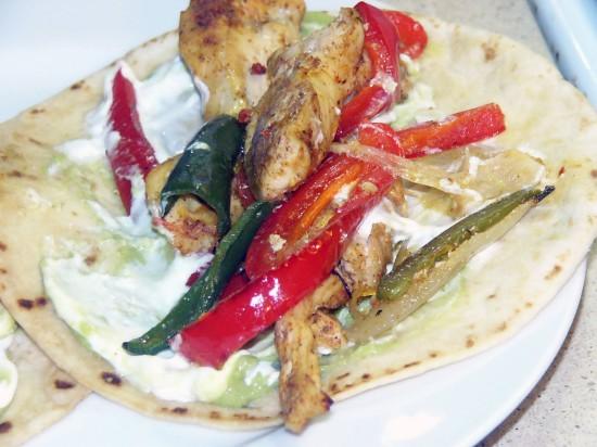 Serve fajitas with warm tortillas and garnish as desires.