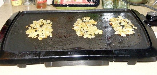 Spread onion out on griddle in the approximate shape as the burgers.