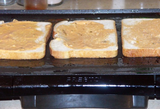 Butter sourdough bread. Place on griddle butter side down. Spread about 1 tablespoon Thousand Island Dressing on bread.
