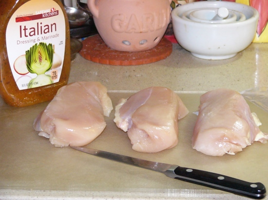 Lay chicken breast on cutting board. Season with salt and garlic powder. Cut into cubes.