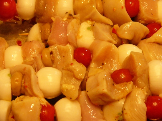 Once marinated, thread chicken cubes, onions, cherry to tomatoes