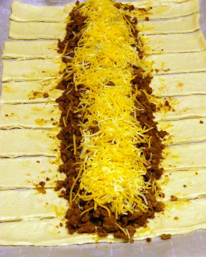 Top meat mixture with cheese.