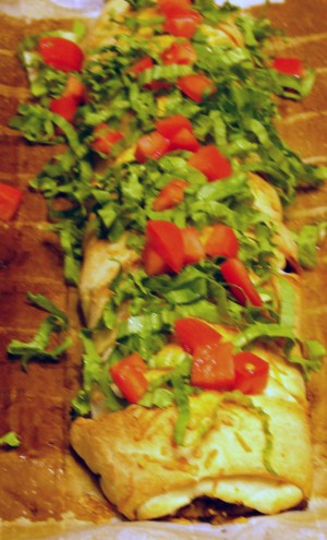 Remove from oven, let cool 5 minutes, then top with shredded lettuce and more diced tomatoes just before serving.